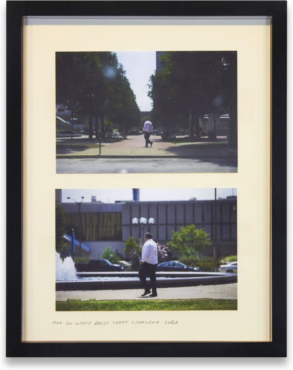 Man in White Press Shirt Carrying Soda. Alec Soth
